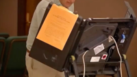 Democracy, Voting and Mail-In Ballots: Assessing Technology's Role in the Election Process