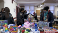 NYPD and Our Lady of Mount Carmel Team Up for Weekly Toy Drive in Astoria